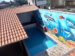 Casa de piscina na Praia grande