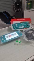 Título do anúncio: Nintendo Switch Lite Turquesa 32GB + 2 Jogos Digitais + 1 Ano de Garantia ( Loja física )
