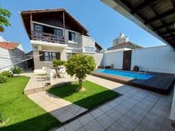 Linda Casa com 4 dormitórios e suíte, dois pavimentos e piscina em Barreiros