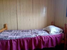 Três camas de solteiro