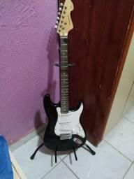 Vendo guitarra com suporte estado de novo