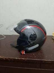 Vendo capacete e manete muito novos.