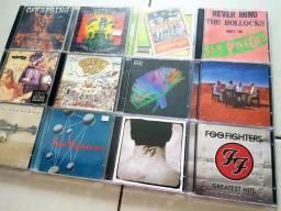 CDs Rock Internacional Oasis Nirvana Green Day ACDC Ozzy Kiss