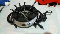 Panela de fondue inox da Oster na caixa