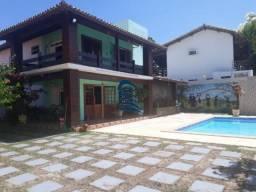 Casa ampla com 5 quartos, sendo 1 suíte, próximo a 2ª portaria de Villas.