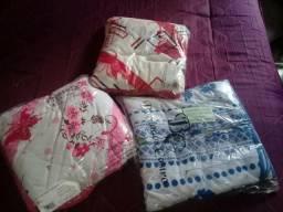 Vendo colchas de cama casal acompanha 2 fronhas. material de malha