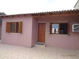 Casa com 3 dormitórios para alugar, 120 m² por R$ 1.750,00/mês - Vila Nova - Porto Alegre/