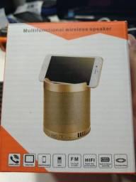 Caixa bluetooth média da pra colocar o celular em cima dela