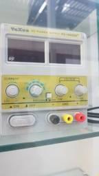 Fonte de bancada yaxum 1502 voltagem 220v