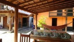 Vende-se 01 casa com 03 suítes, 4 chalés e 1 kitnet no mesmo lote no bairro Taperapuã