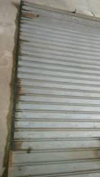 Vendo esta porta de enrolar semi_nova