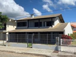 Casa com 3 dormitórios à venda em frente à praia, 322 m² por R$ 1.500.000 - Ubatuba - São