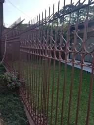 Grade com portão em ferro maciço