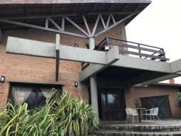 Casa com 3 dormitórios à venda, 298 m²