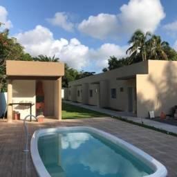 Village com 2 dormitórios à venda por R$ 210.000,00 - Barra do Jacuípe - Camaçari/BA