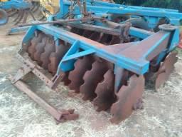 Grade aradora 18/28 trator