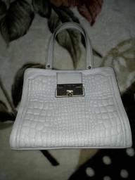 Troco essa linda bolsa de couro nova em Melissa N: 37 ou 38