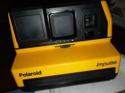 Camera antiga polaroid ku