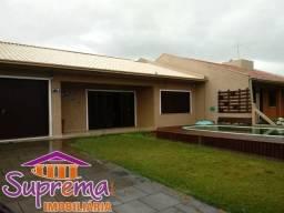 A55 Casa com piscina no centrinho de Mariluz, Imperdível! Garanta suas férias!