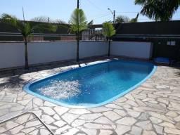 Casa beira mar com piscina com aquecimento solar meio quarteirão da Praia temporada.