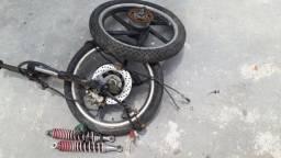 Rodas de liga leve com discos e suspensão aro 17  modelo da biz