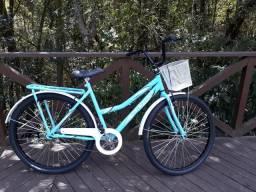 Promoção de natal bicicleta ultra bike aro 26 na cor azul claro. modelo retrô