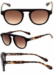 4ed6e57872df4 Óculos de sol Evoke 100% Original com lestes transition Nota Fiscal Garantia