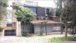 Ampla Casa Comercial/Residencial no bairro Petrópolis.