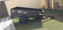 Uma carrocinha com dois pneus novos avenda 2500 reais