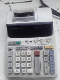 Vendo calculadora sharp visor e fita semi nova