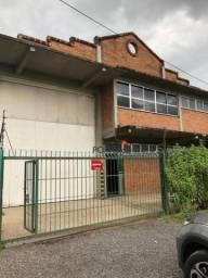 Depósito com 540 m² privativos, piso industrial, pé direito de 10 m, portão 8 m, andar com