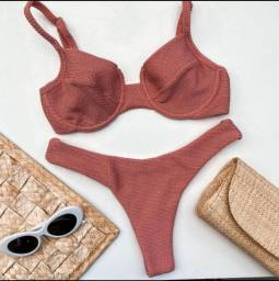 Confecção busca costureira interna de moda praia