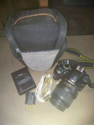 Câmera Nikon d3100  com lente 18-55
