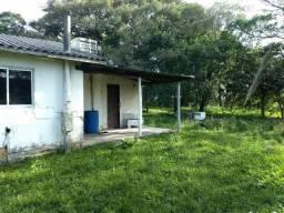 Vendo terreno em Imbituba frete para br 101 fundos com a Lagoa