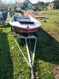 Barco de fibra com motor de rabeta 5,5 hp