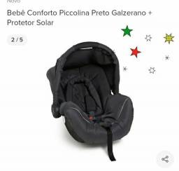 Bebê conforto  com protetor solar