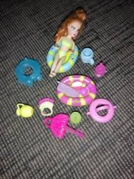 Título do anúncio: Boneca Polly com alguns acessórios variados