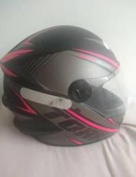 Vendo uma capacete semi Novo