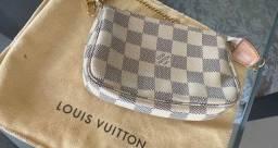 Mini pochette acompanha dust bag