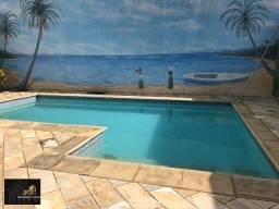 Casa com 02 quartos, edícula, área gourmet com piscina, próximo a lagoa