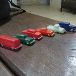Carrinhos de plástico antigos dos modelos da promoção da toddy antiga