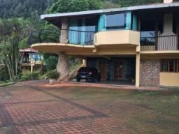Casa de alto padrão em Condomínio, com 550m² de área construída e 3.200m² de terreno