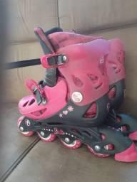 Vendo esse  patins com todos assessórios