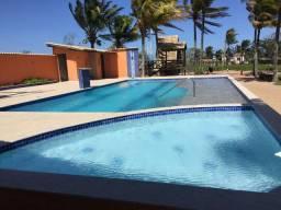 Encantador terreno em Condomínio Portal da Praia!