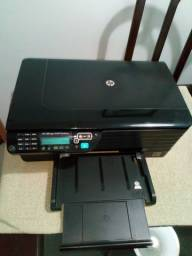 Vendo, uma  impressora tudo funcionando