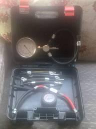 Manometro de pressão com todas a mangueira e um manometro de vazão