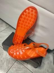 Melissa possession print laranja, linda e confortável
