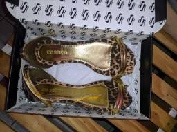 Sandália rasteirinha onça dourada