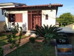 Villarinho Imóveis vende excelente terreno 350m² c/2 casas, entradas independentes, casa d
