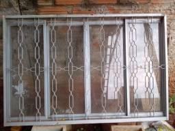 Janela 1,50 x 1,00 m Sasazaki, com grade e vidros